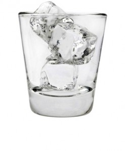 cutcaster-photo-100544920-Empty-glass-tumbler-with-ice-cubes-on-a-white-background